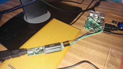 A dsPIC33 Microstick connected via serial to a Raspberry Pi